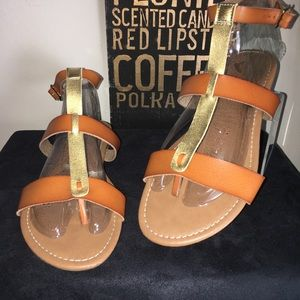 Tan and gold ankle strap flats